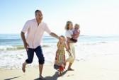 18718939-grandparents-and-grandchildren-enjoying-beach-holiday