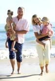 18720048-grandparents-and-grandchildren-enjoying-beach-holiday